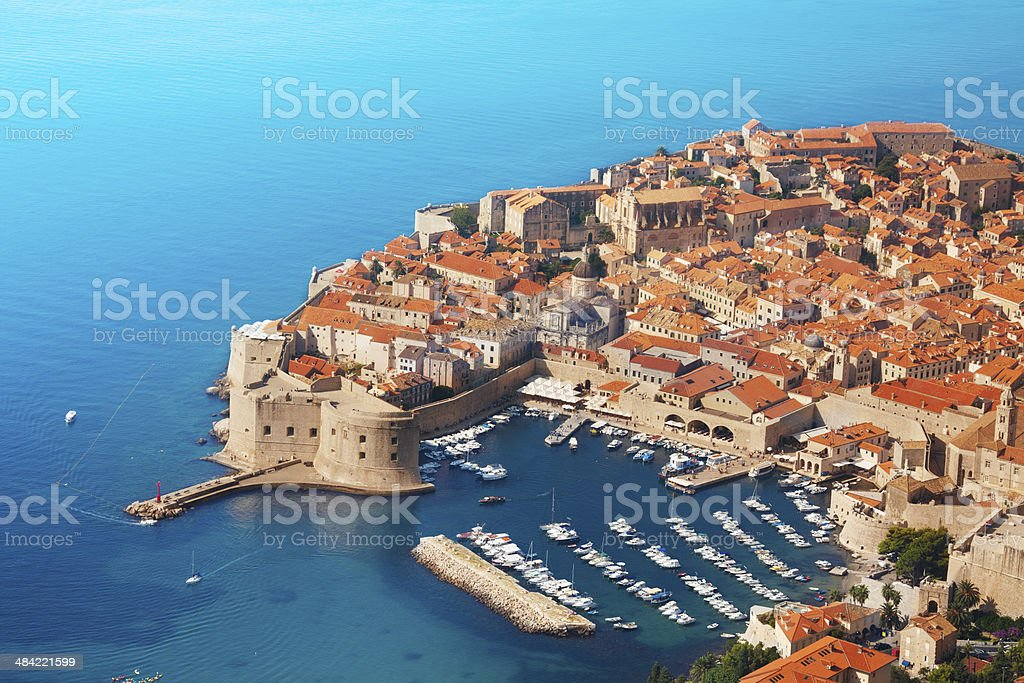 Boats at Dubrovnik old town port stock photo