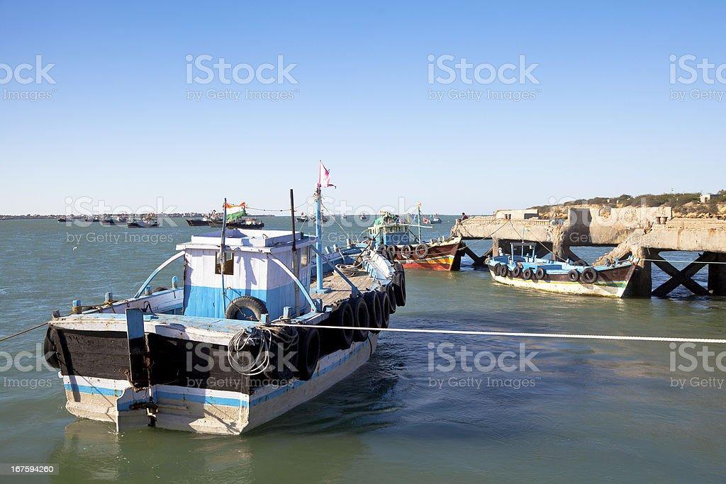 Boats at Dusk moored in Dwarka Harbor royalty-free stock photo