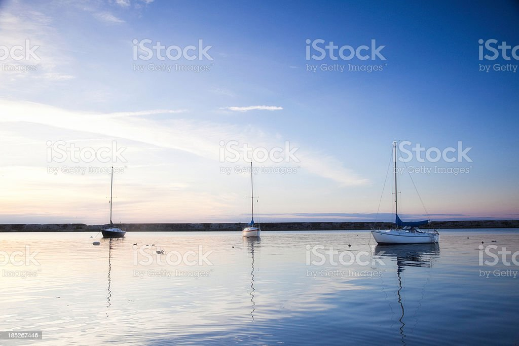 Boats at Dusk stock photo