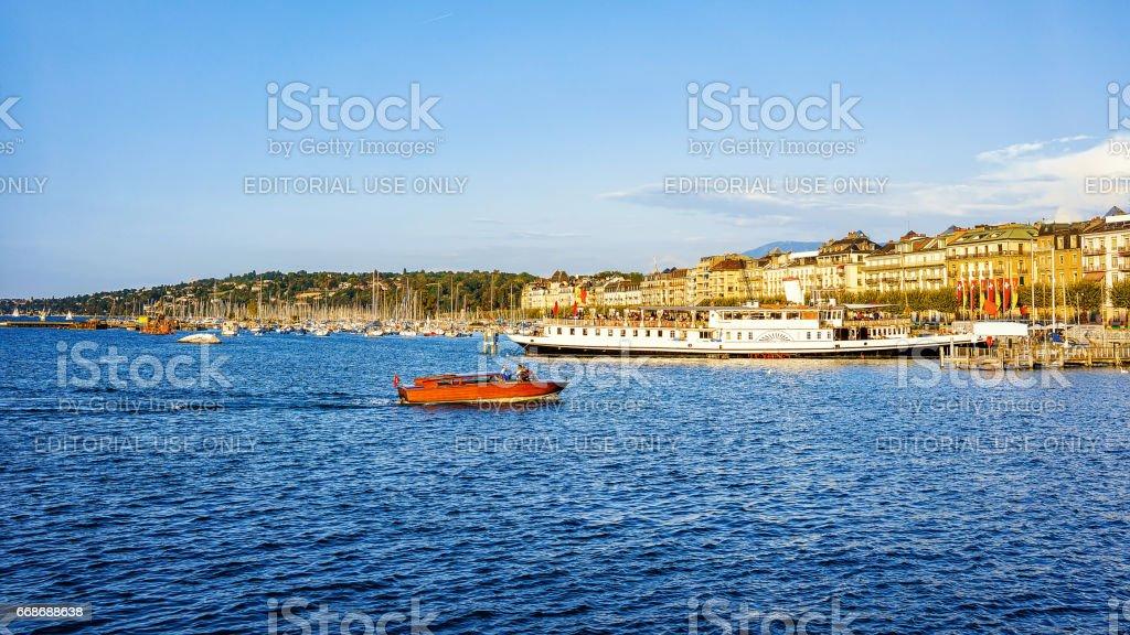Boats at Geneva Lake at Promenade du Lac in summer stock photo