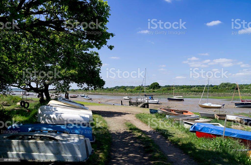 Boats at Holbrook Creek, Suffolk stock photo