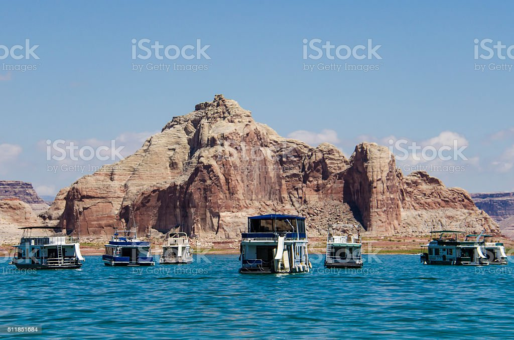 Boats at Lake Powell with Canyons in Background stock photo