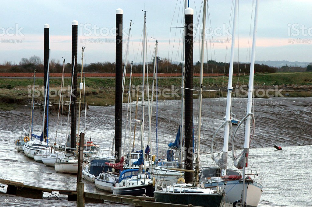 Boats at low tide stock photo