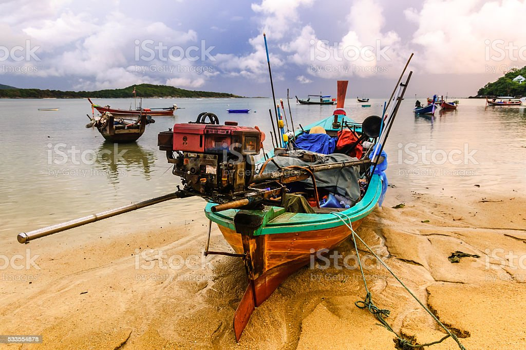 Boats at low tide, Rawai beach, Phuket, Thailand stock photo