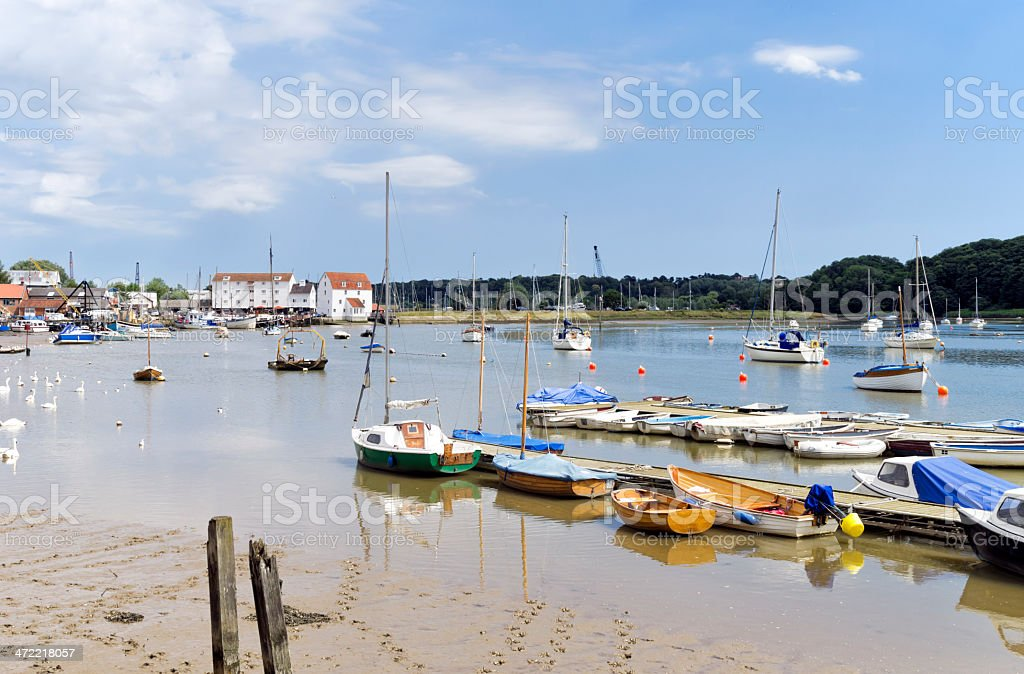Boats at low tide, Woodbridge, Suffolk stock photo