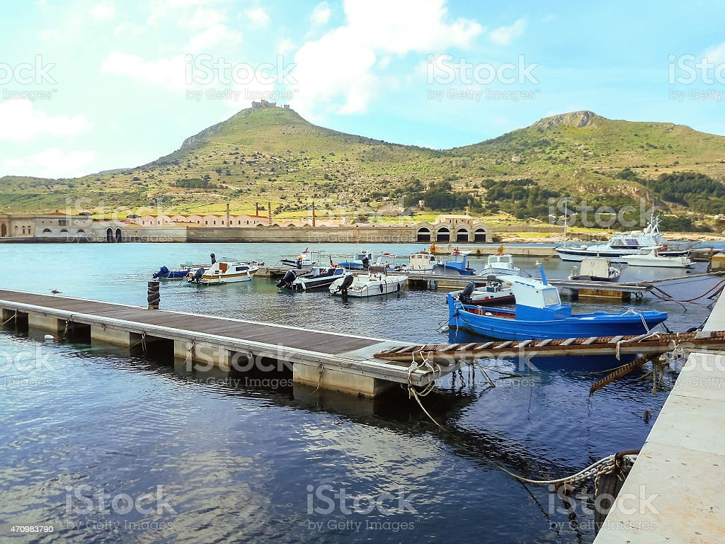 Boats at pier in the southern Italian port stock photo