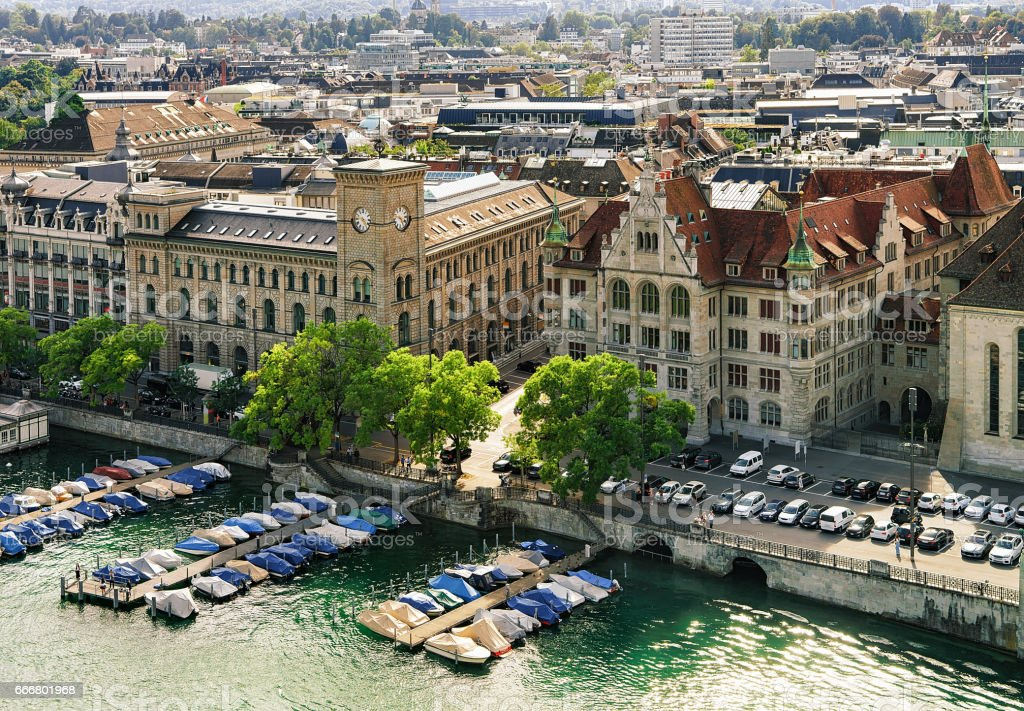 Boats at Post office and Stadthaus at Limmat River Zurich stock photo