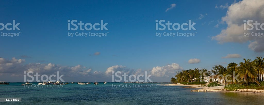 Boats at Sunset, Grand Cayman stock photo