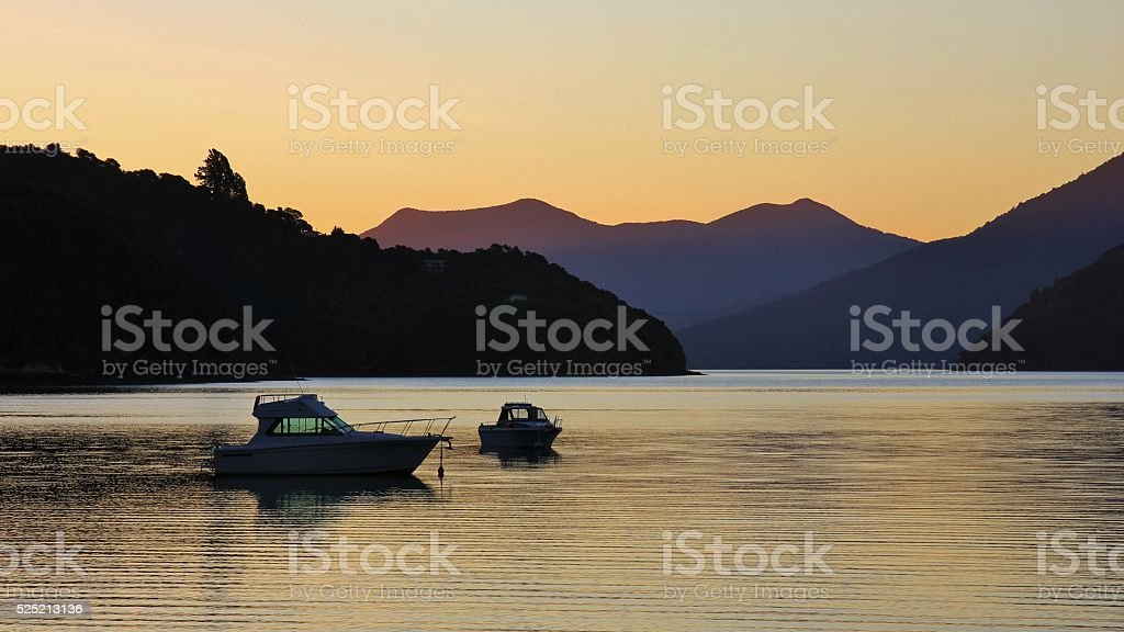 Boats at sunset in Portage Bay stock photo