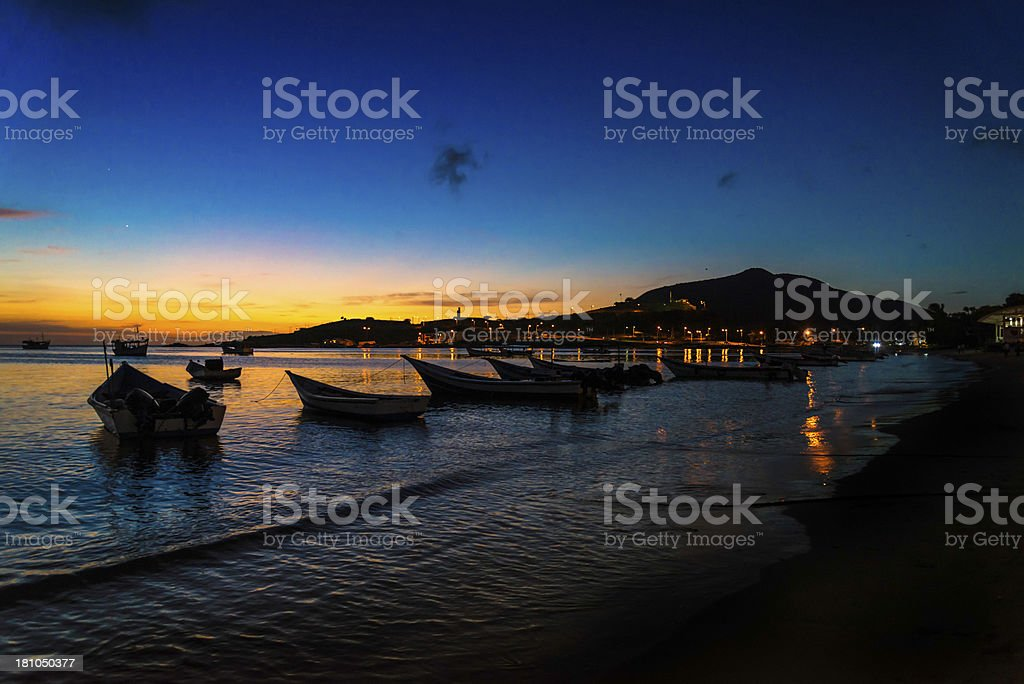 Boats at sunset Margarita island Venezuela royalty-free stock photo