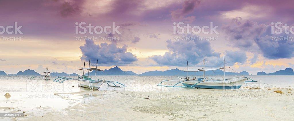Boats at sunset. Panorama stock photo