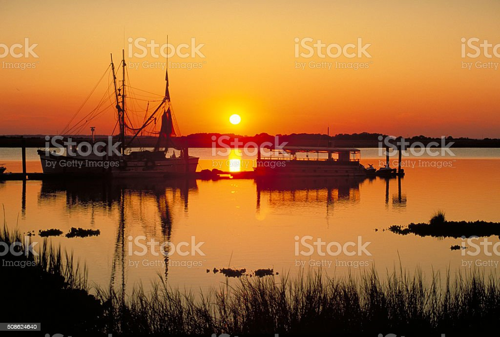 Boats at Sunset stock photo