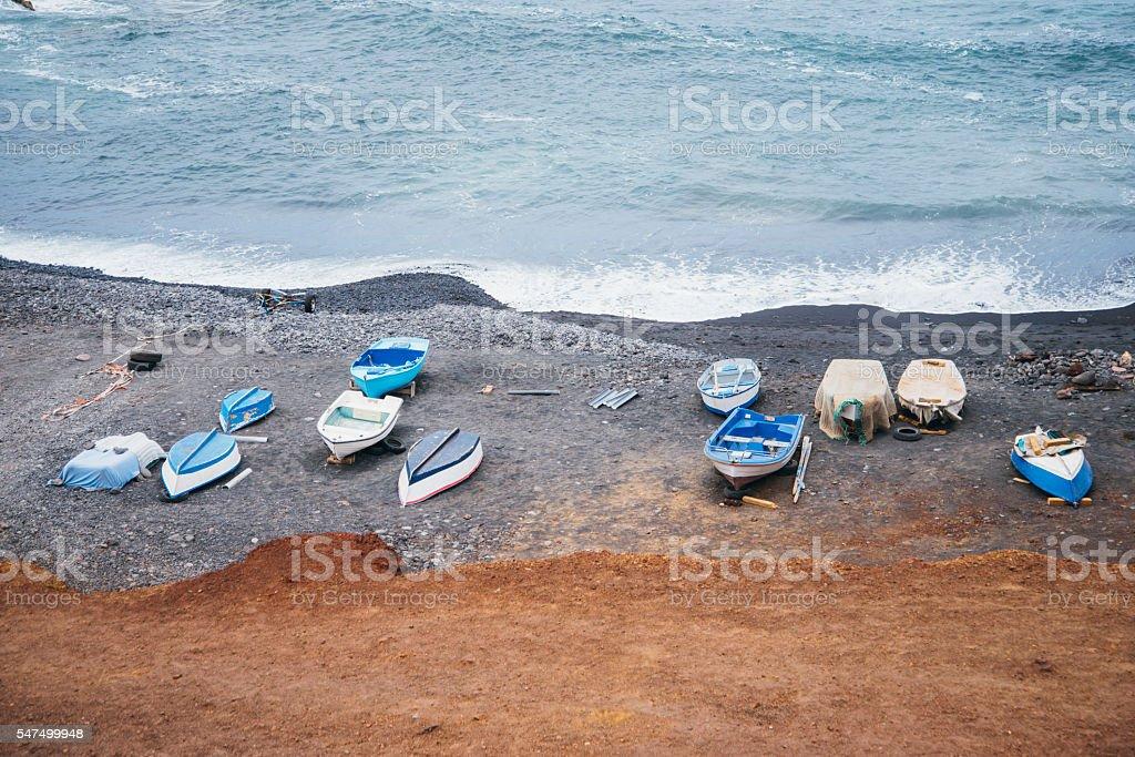 Boats at the beach stock photo