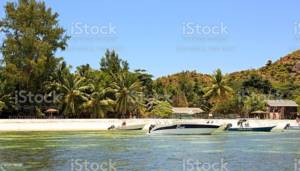 Boats at the beautiful beach of Curieuse Island in Indian stock photo