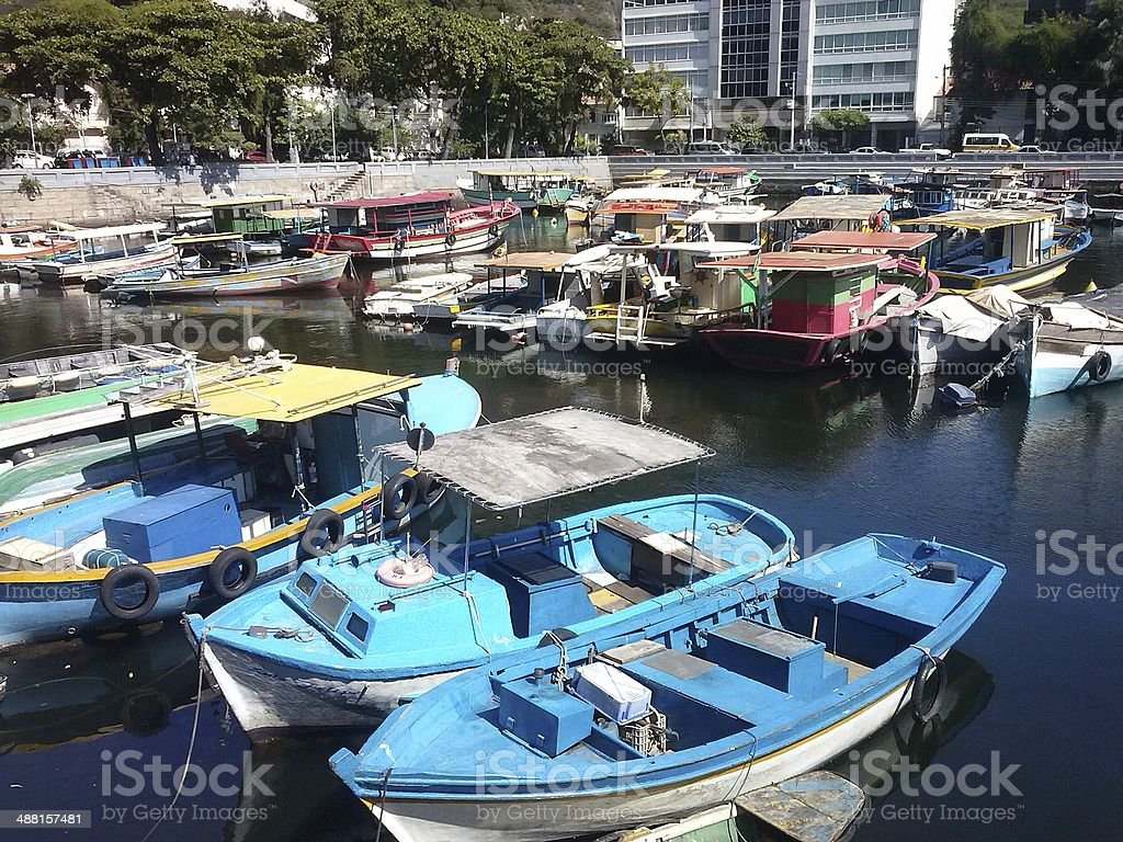 Boats awaiting tourists and hours of fishing in the marina royalty-free stock photo