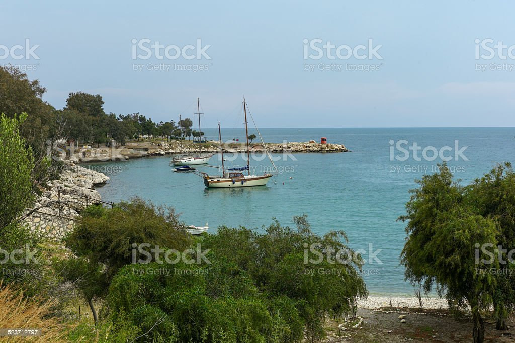 boats by narlikuyu beach of mersin turkey stock photo