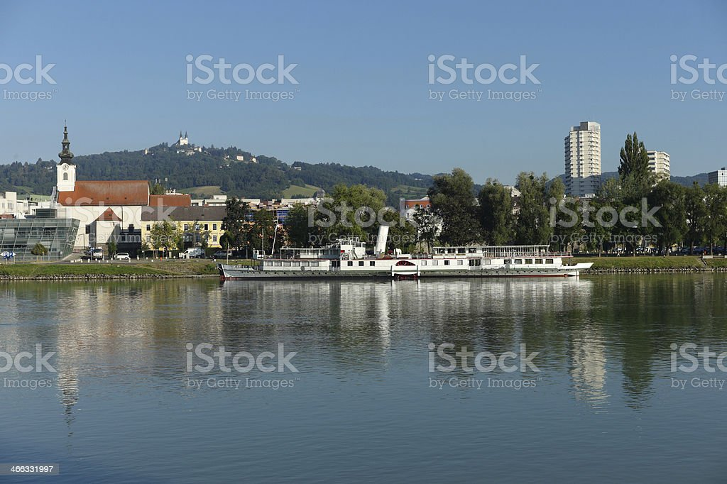 boats by the danube river at linz austria stock photo