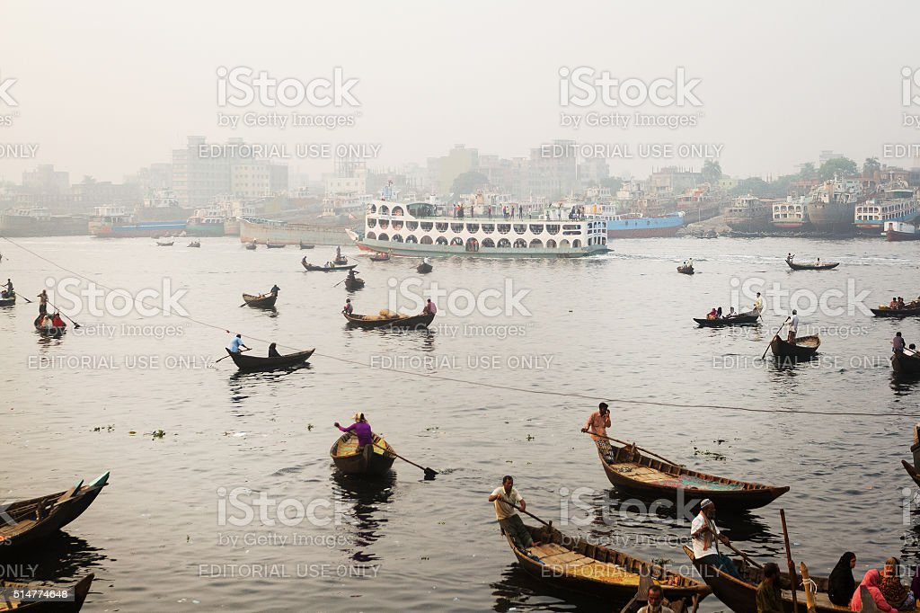 Boats carrying passengers across river Buriganga stock photo