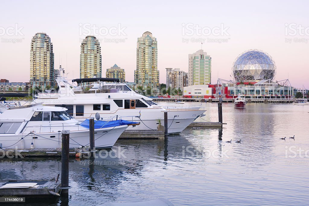 Boats, condos and Science World at False Creek in Vancouver royalty-free stock photo