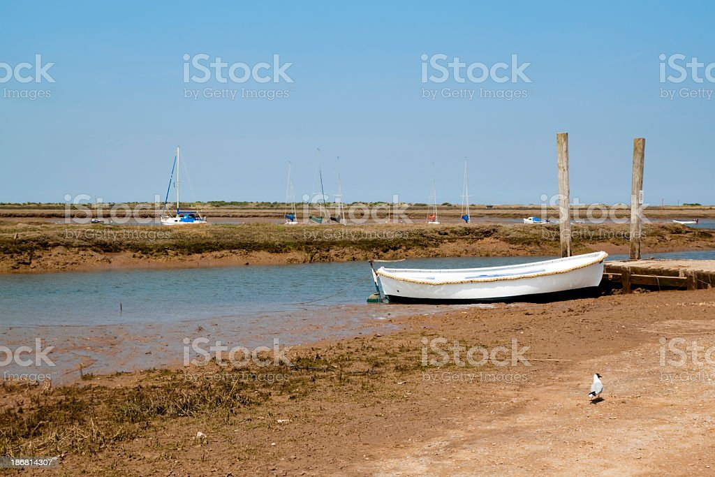 Boats, creeks and marshes at Brancaster Staithe, Norfolk royalty-free stock photo