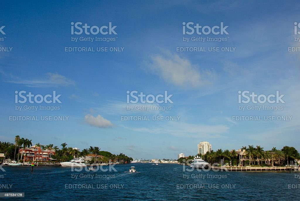 Boats cruise the New River in Fort Lauderdale stock photo
