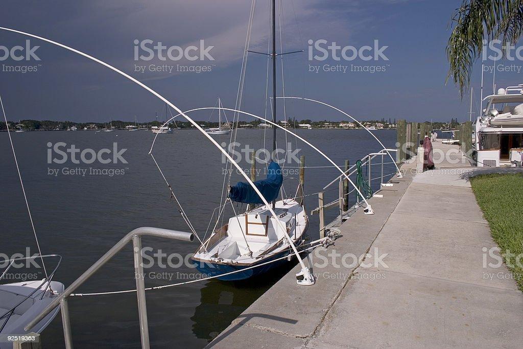 Boats Docked Along Sea Wall stock photo