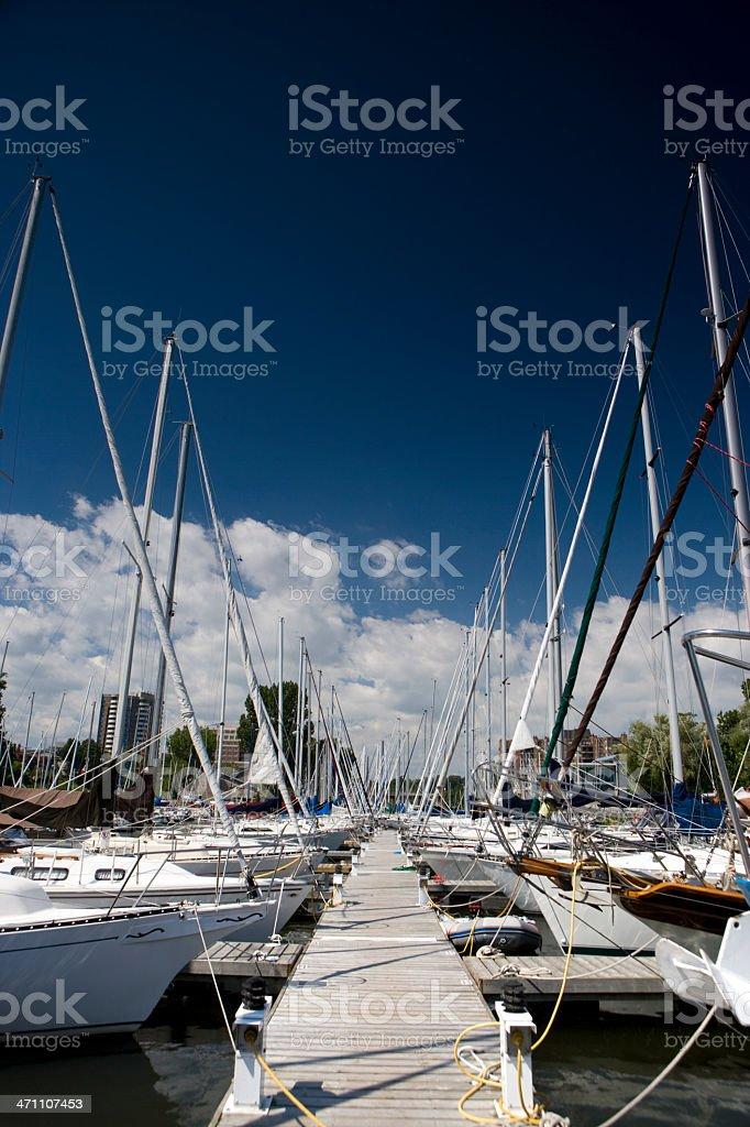 Boats docked at a pier royalty-free stock photo