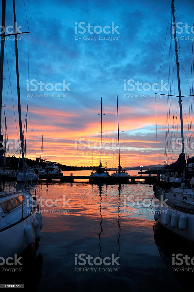 Boats in a harbor at sunset royalty-free stock photo