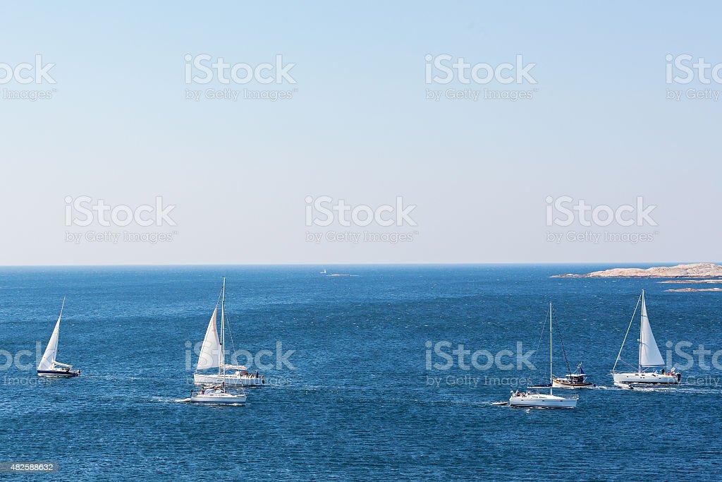 Boats in a sea lane on the coast stock photo