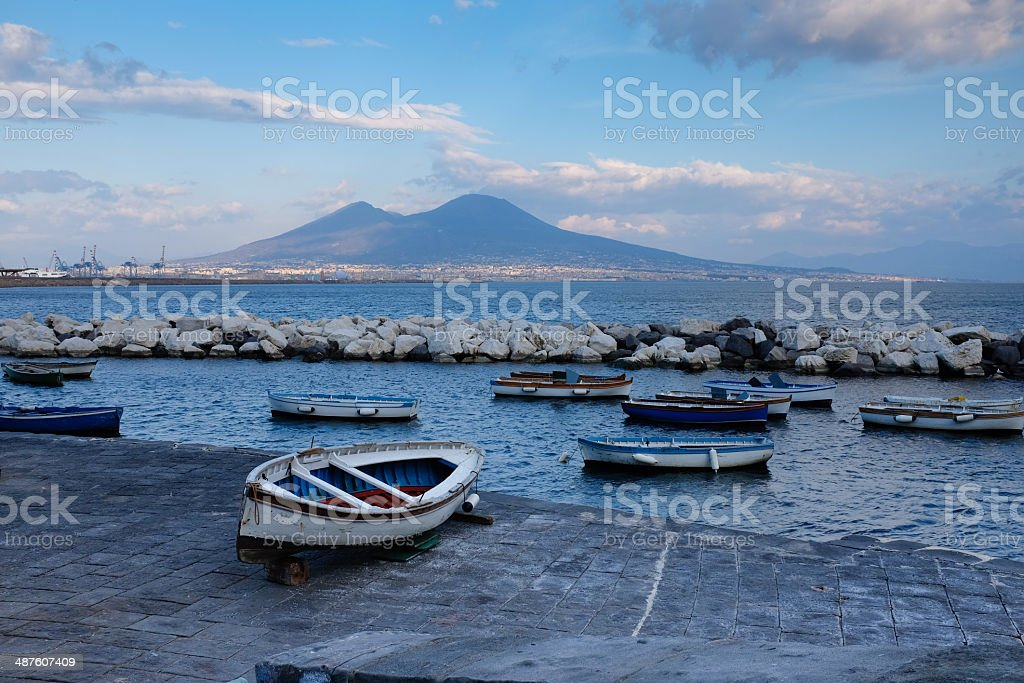 Boats in bay of Naples and Vesuvius stock photo