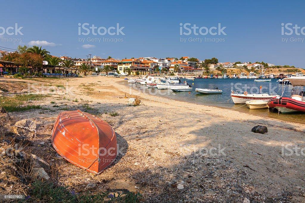 Boats in Bay of Nea Fokia village, Halkidiki, Greece. stock photo