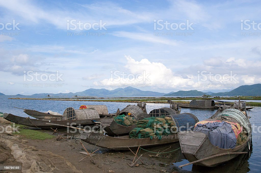 Boats in bay with mountains and cloud at background royalty-free stock photo
