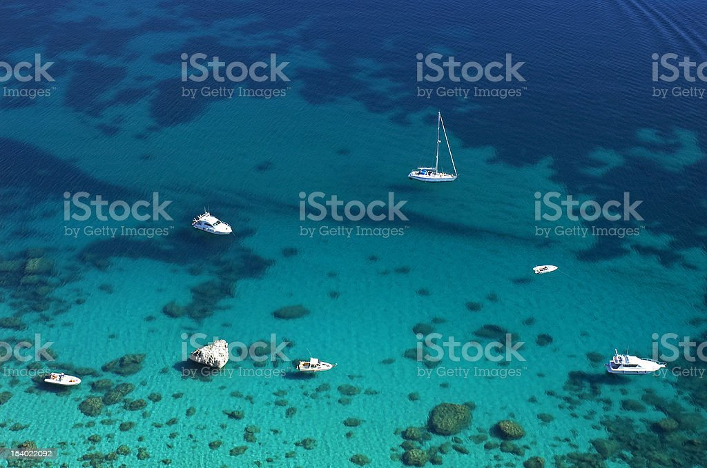 Boats in blue sea stock photo