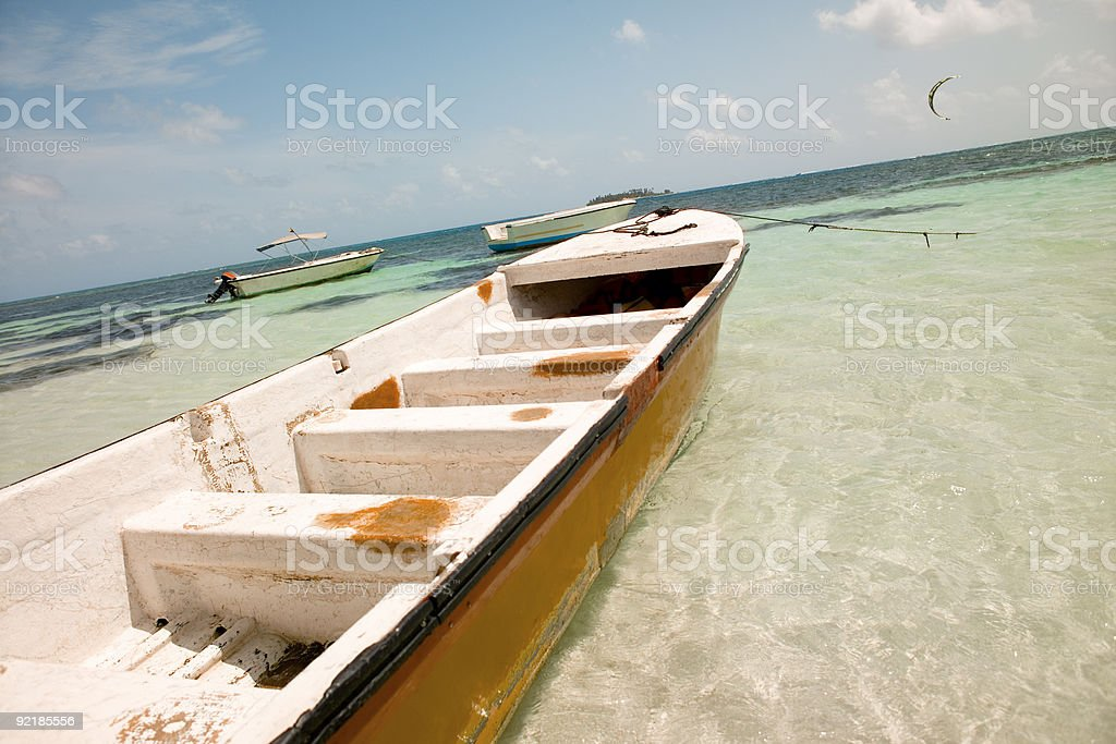 Boats in clear blue water at San Andres Island, Colombia stock photo