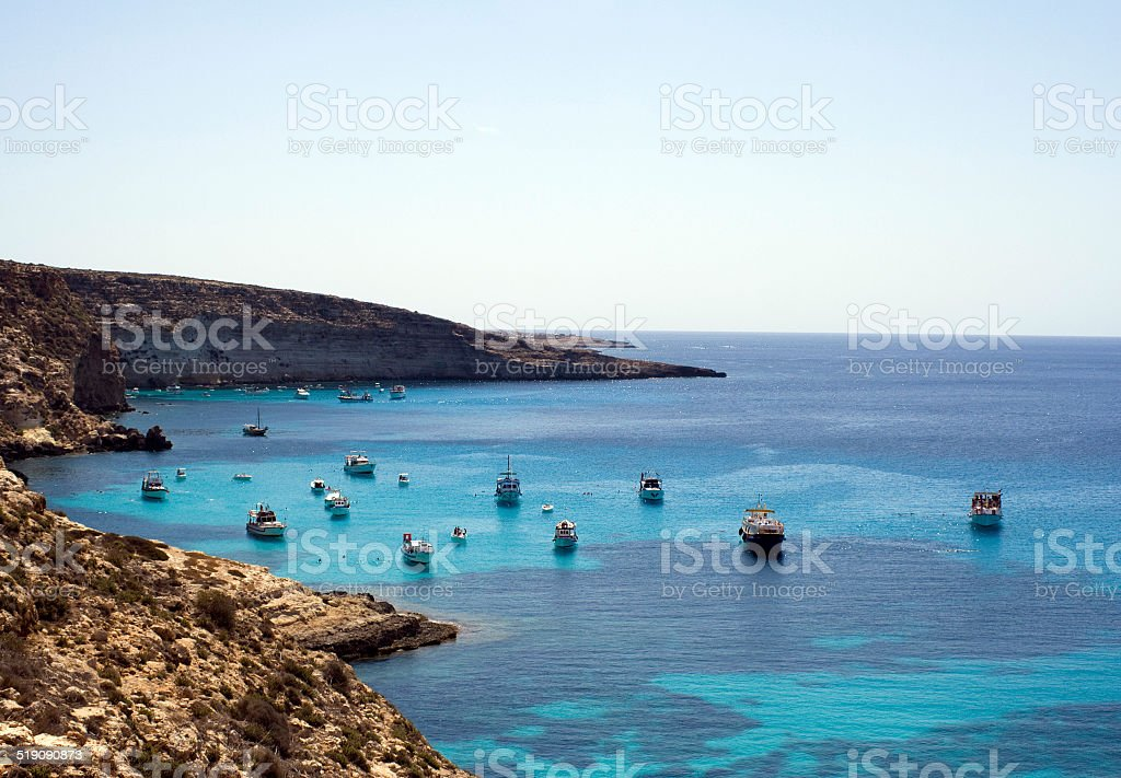 Boats in crystalline water stock photo