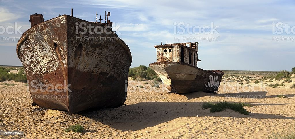 Boats in desert around Moynaq - Aral lake - Uzbekistan - asia stock photo