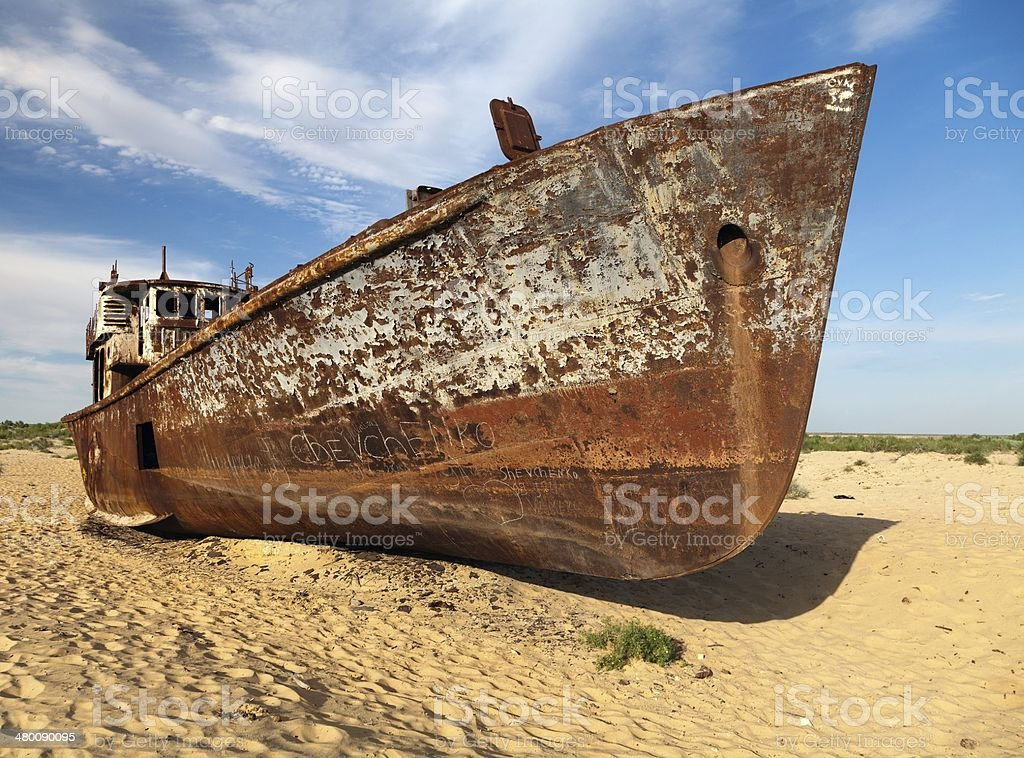 Boats in desert around Moynaq - Aral sea or Aral lake stock photo