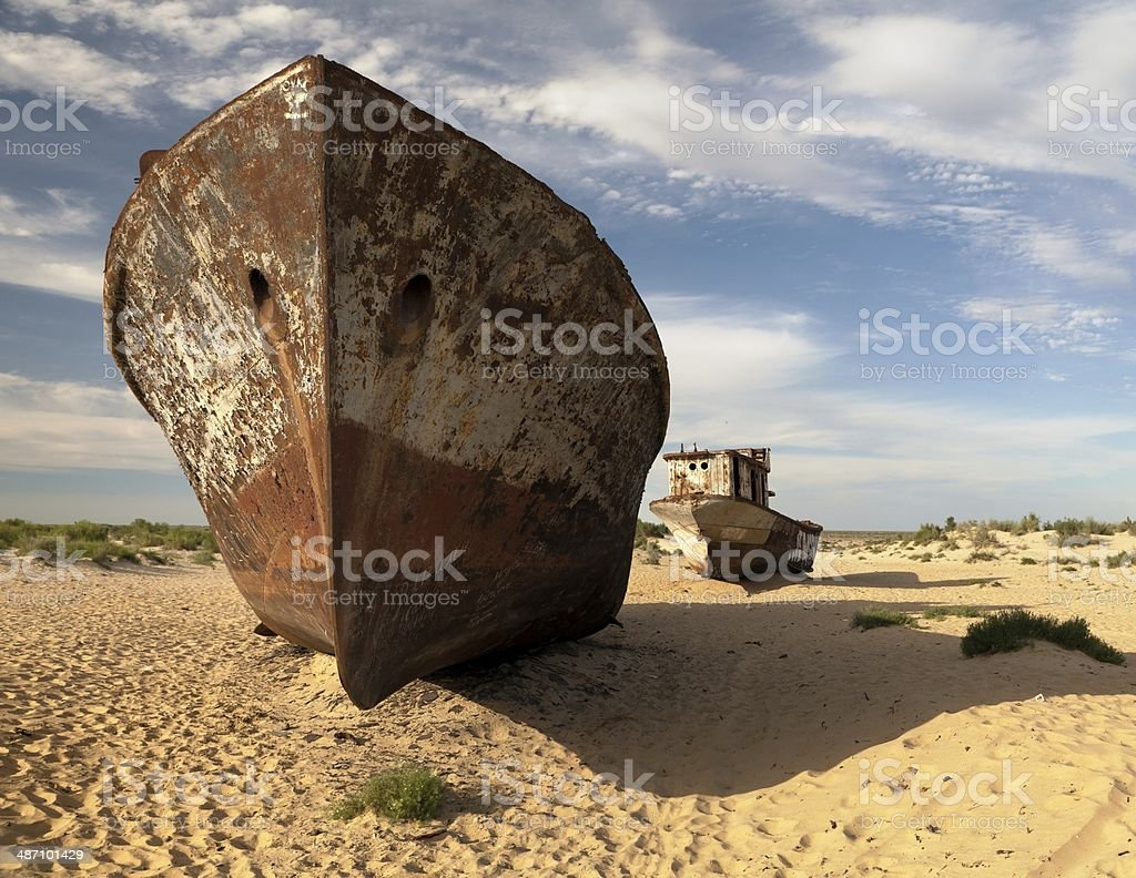 Boats in desert around Moynaq - Aral sea or Aral lake stock photo