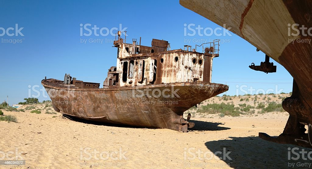 Boats in desert around Moynaq - Aral sea stock photo