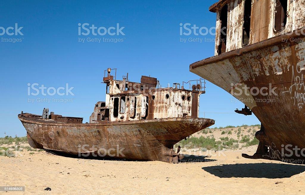 Boats in desert around Moynaq - Aral sea stock photo