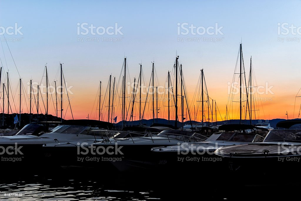 boats in dock at sunset stock photo
