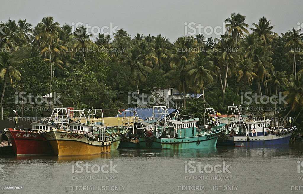 Boats in dock on a river royalty-free stock photo