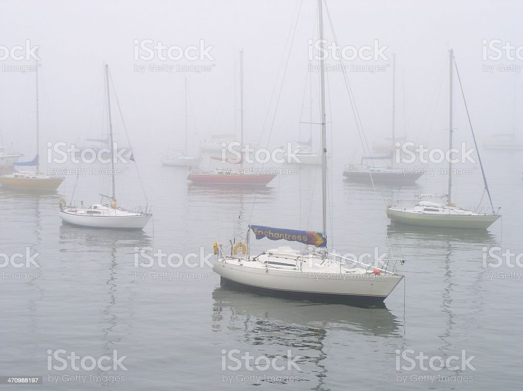 boats in fog stock photo