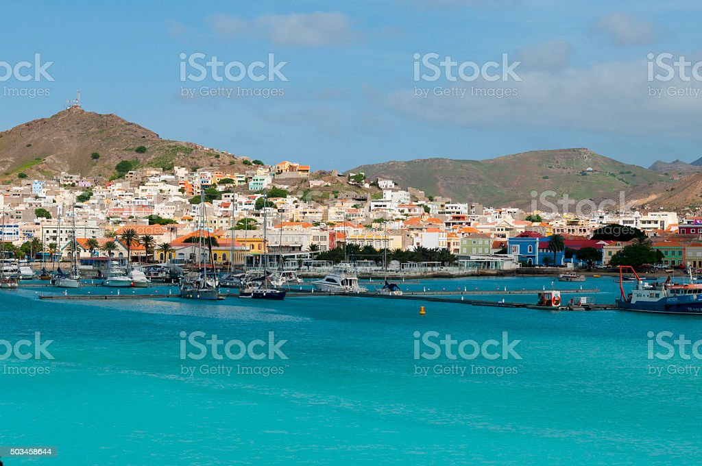 Boats in front of small town at the blue ocean stock photo