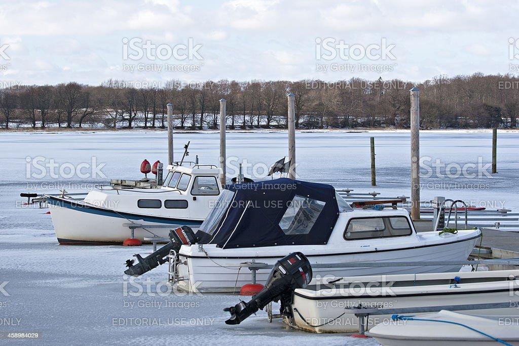 Boats in frozen water outside Præstø port. royalty-free stock photo