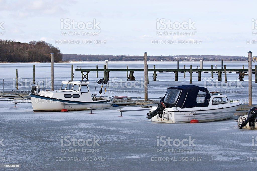 Boats in frozen water outside Præstø port royalty-free stock photo