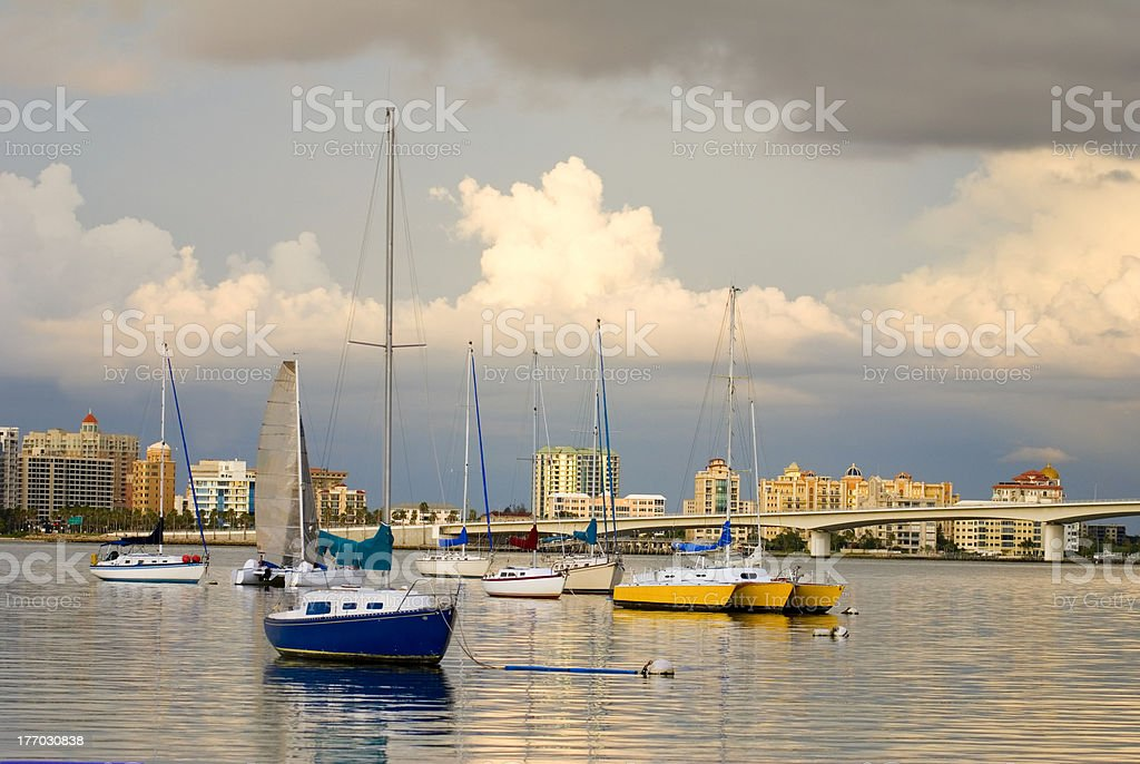 Boats in Harbor Under Cloudy Skies stock photo