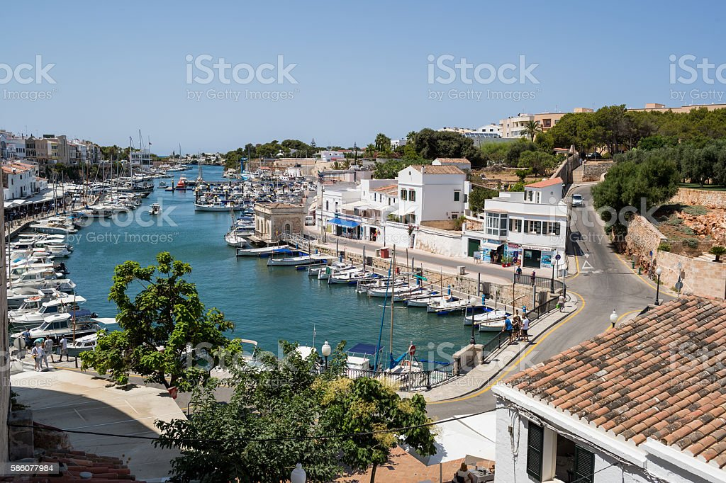 Boats in harbour with bridge and houses stock photo