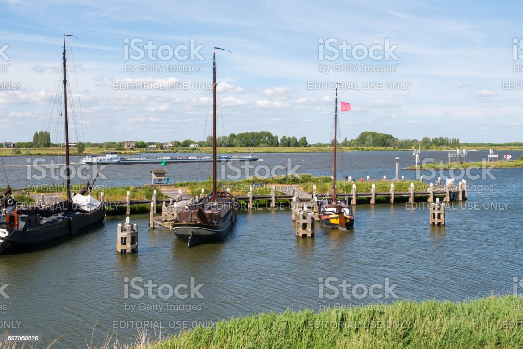 Boats in historic harbour of fortified town of Woudrichem, Netherlands stock photo