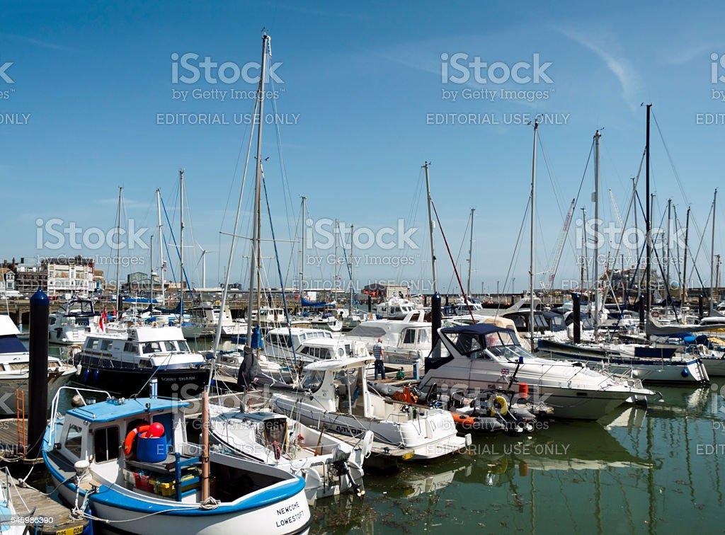 Boats in Lowestoft marina stock photo